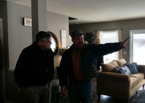 "Tim showing details of new lot model to Doug, owner of ""Do It Best"" in Bangor,"